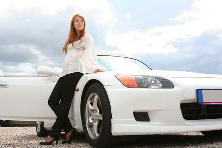 beautiful young woman with white luxury car Stock Photo - 5938073