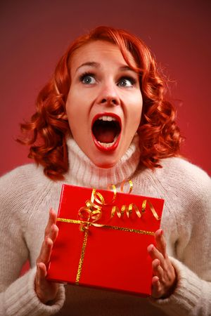 cute redhead girl with present Stock Photo - 5933577