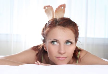 beautiful young woman relaxing on bed Stock Photo - 5933565