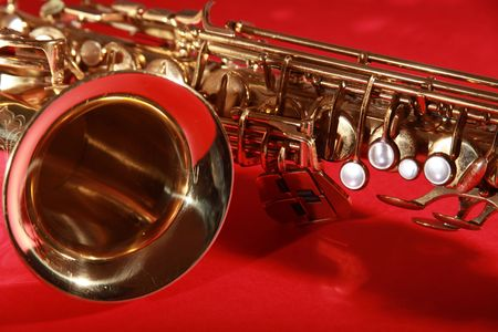 golden shiny saxophone on red background Stock Photo - 5937190
