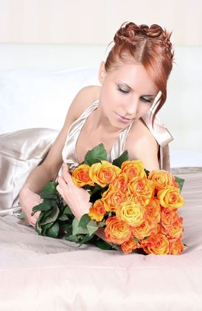 beautiful young woman with bunch of roses Stock Photo - 5933559