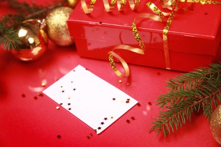 christmas background with golden balls and present Stock Photo - 5937187