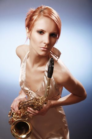 sexy young woman with saxophone photo