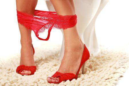 面白い女の子のトイレで赤い靴