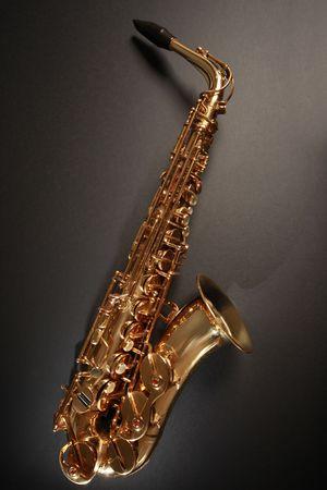 shiny golden saxophone on black background Stock Photo - 5937191