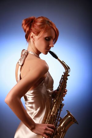 sexy young woman with saxophone Stock Photo - 5933567