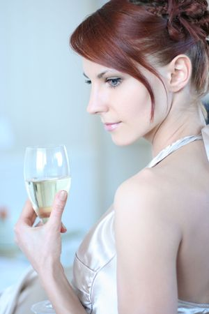 beautiful young woman drinking champagne  photo