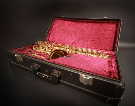 shiny golden sax in suitcase Stock Photo - 5937188