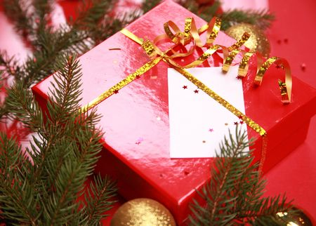 christmas background with golden balls and present Stock Photo - 5937189