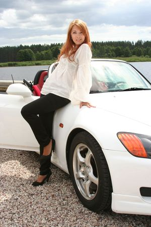 beautiful young woman with white luxury car Stock Photo - 5933568