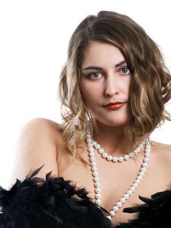 Retro-styled girl with beads and boa on white background photo