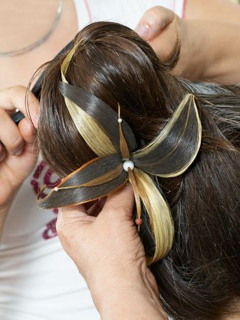 attaching: attaching artifical flower to hairs