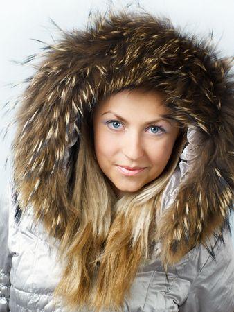fur hood: Beautiful blonde girl in fur hood looking straight and smiling