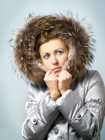 comely: Young women in fur hood with worried expression on face. Stock Photo