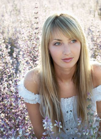 beautiful blonde girl with long hair at sage field photo