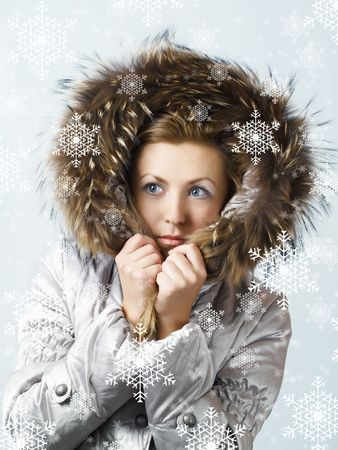 Young women under snow wearing a winter jacket Stock Photo - 3677686