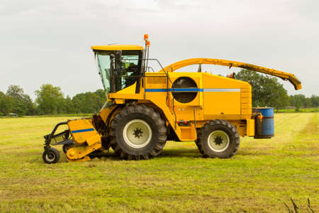 a shredding machine in yellow with a blue sky as background.