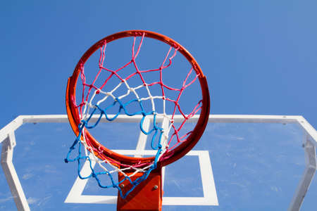 one with basketball backboard in the blue sky photo