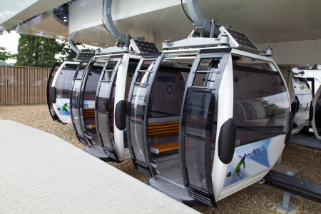 cableway: three cable car cabins waiting on the platform