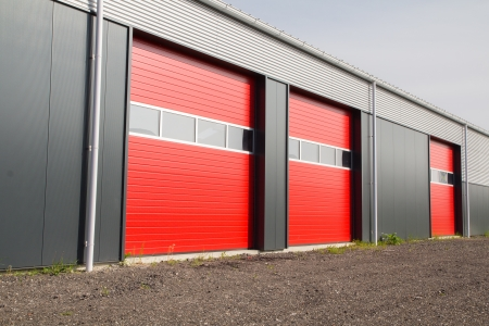 three red shed doors in a row