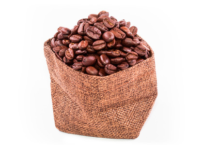 Coffee beans in a burlap bag isolated on white background  with clipping path.