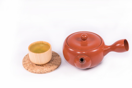 spa still life: Hot green tea so delicious and teapot on white background. Stock Photo