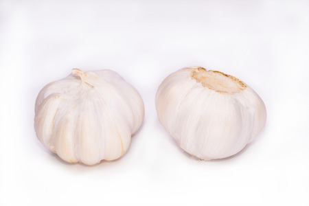 flavouring: Fresh garlic isolated on white a background