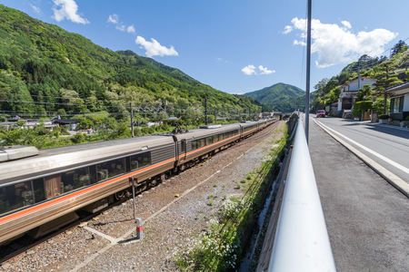Passenger train on railway at Narai  is a  small town in Nagano Prefecture Japan ,The old  town provided a pleasant walk through about a kilometre