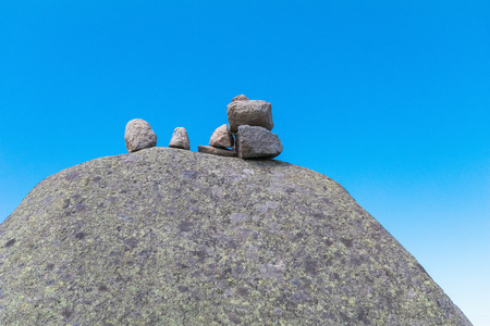 Zen stones on rock for  meditation  on the blue sky background  at Utsukushigahara is  one of the most important and popular natural place in Nagano , Japan.