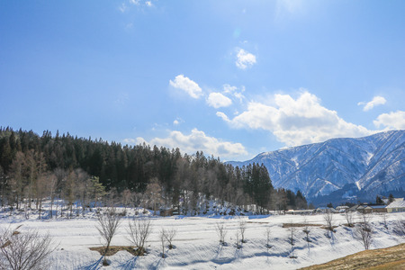 Hakuba mountain range    in the winter with snow on the mountain and blue sky and clouds background in Hakuba  Nagano Japan. Stock Photo