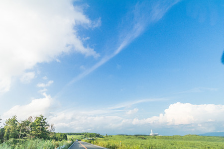 Beautiful landscape view and a country road in spring day with blue sky background of Yamanashi Prefecture, Japan.