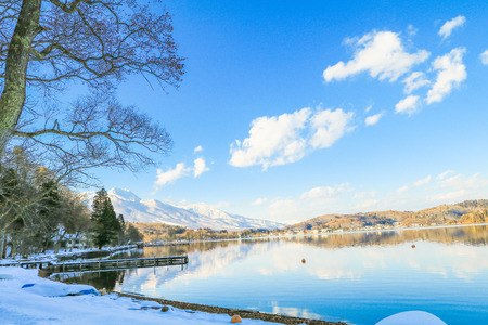 Beautiful fresh snow in winter around the mountains  Lake and tree  with blue sky  background, Nagano Prefecture, Japan. Stock Photo