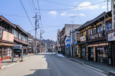 Takayama, JAPAN - ?March 04, 2018: The old  town or traditional cityscape of  Takayama  for  the travelers walking at the old street in Gifu Prefecture, JAPAN.