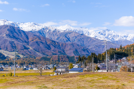 Beautiful landscape view of  Hakuba in the winter with snow on the mountain and blue sky background in Nagano Prefecture Japan. 免版税图像