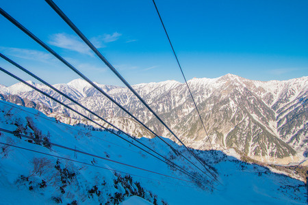 Cable car line of Tateyama Kurobe alpine  in sunshine day with  blue sky background is one of the most important and popular natural place in Toyama Prefecture, Japan.