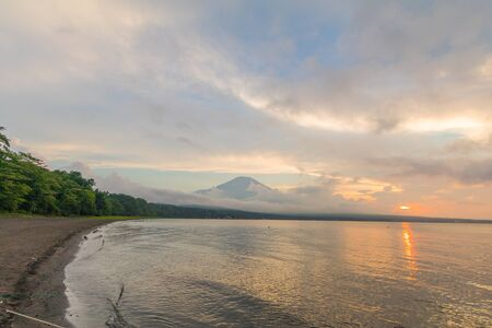 Mt. Fuji and sunset with sun rays at Lake Kawaguchiko, the most famous place in Japan to traveling in Yamanashi Prefecture, Japan