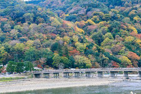 Beautiful Togetsukyo bridge in Arashiyama Kyoto Japan in autumn season .