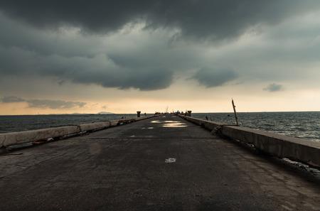 nimbus: Bridge spanning the Bangsaen sea with nimbus