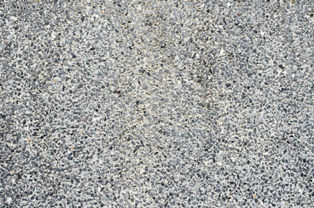 aggregate: rough texture surface of exposed aggregate finish, Ground stone washed floor, made of small sand stone in gray color