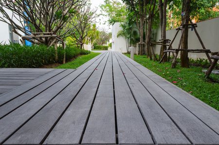 timber bench seat: walkway on the grass