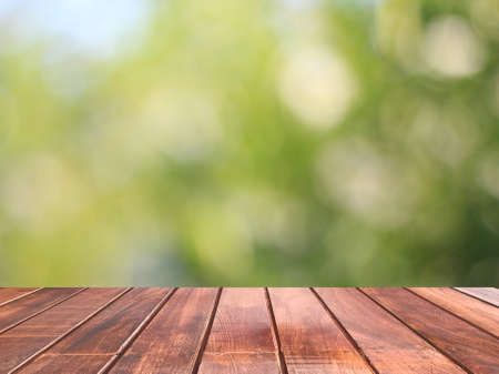 Wooden table with green bokeh is background, Wooden table top 免版税图像