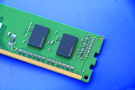 DDR RAM memory module isolated on blue background