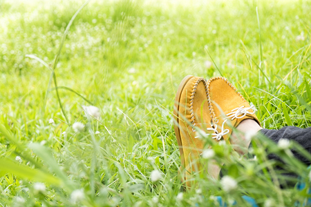 young woman sit on green grass, Freedom and Relax concept, soft focus, vintage tone