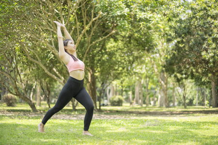 saxy: beautiful woman relax yoga in the park Stock Photo