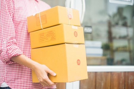 happy women holding parcel of box for delivery, business owner concept Stock Photo