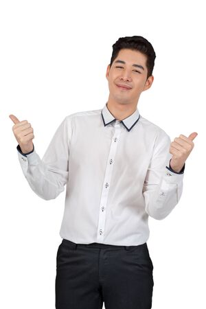 Happy young businessman show thumb up in suit looking at camera on white background, isolated concept