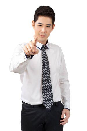 Feliz joven empresario mirando la mano en traje sobre fondo blanco, concepto aislado Foto de archivo