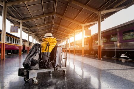traveling luggage and passenger train at the train station, travel concept Banco de Imagens