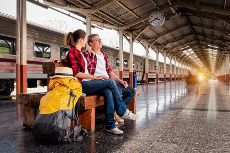 Young traveling backpacker on vacation at the train station, travel concept