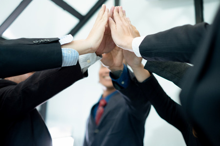 businesspeople raise hand high fives together.businesspeople celebrating in office success deal business, business concept, business success concept